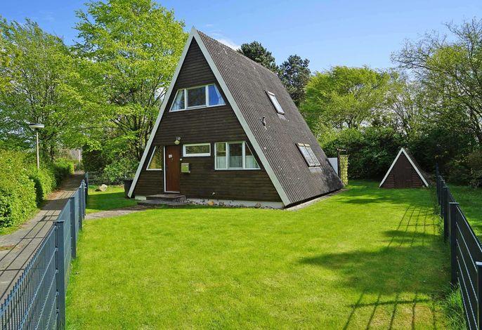 Zeltdachhaus mit Zaun