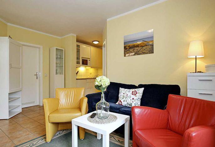Wohnbereich mit Sofa und 2 Sessel