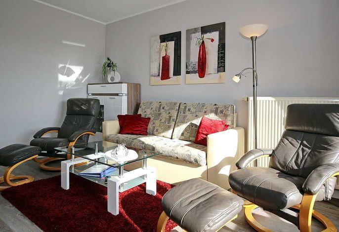 Wohnbereich mit Sofa und Sesseln