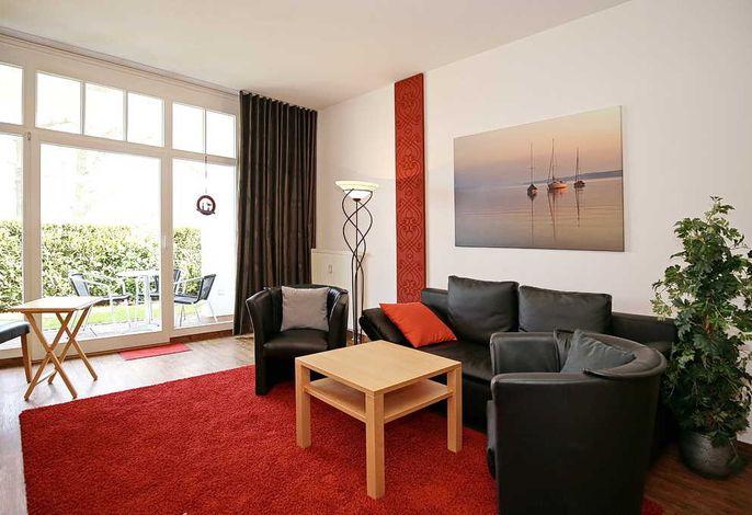 Wohnbereich mit Sofa und 2 Sesseln