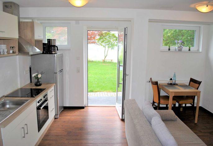 Wohn- & Essbereich mit Küchenzeile