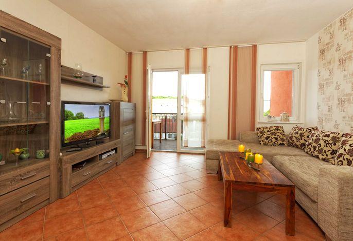 Couch & TV Zugang zum Balkon