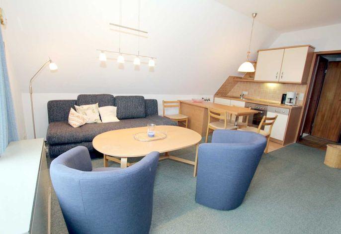 Wohnzimmer mit gemütlicher Sitzecke