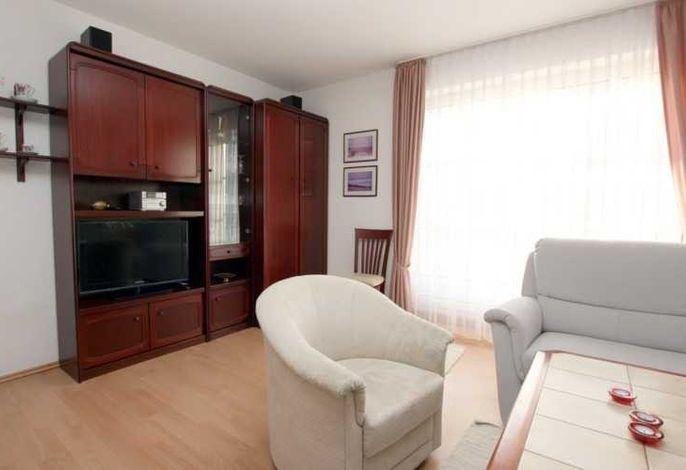 Wohnzimmer mit Süd/Westbalkon