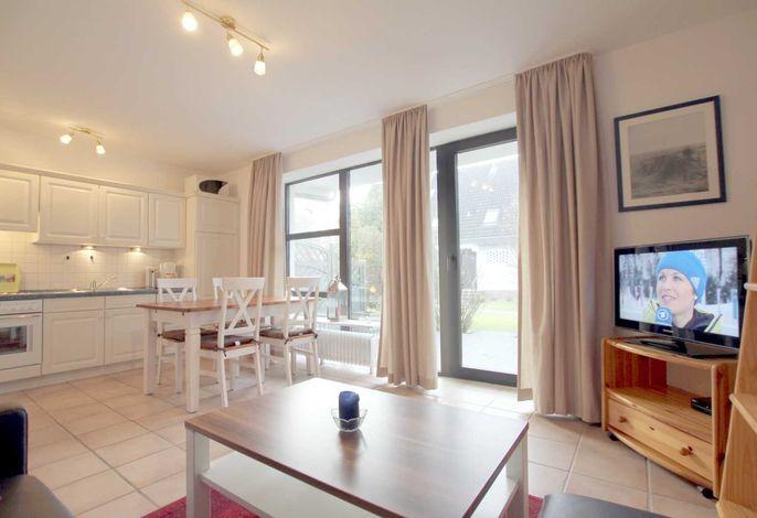 Wohnzimmer mit direktem Ausgang auf die eigene Terrasse