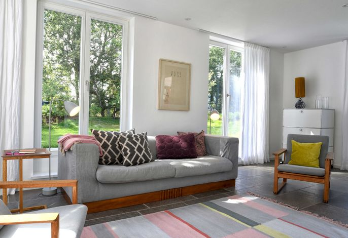 In den Wohnbereichen sowie im Untergeschoss und im Bad befinden sich Mylin-Fliesen.
