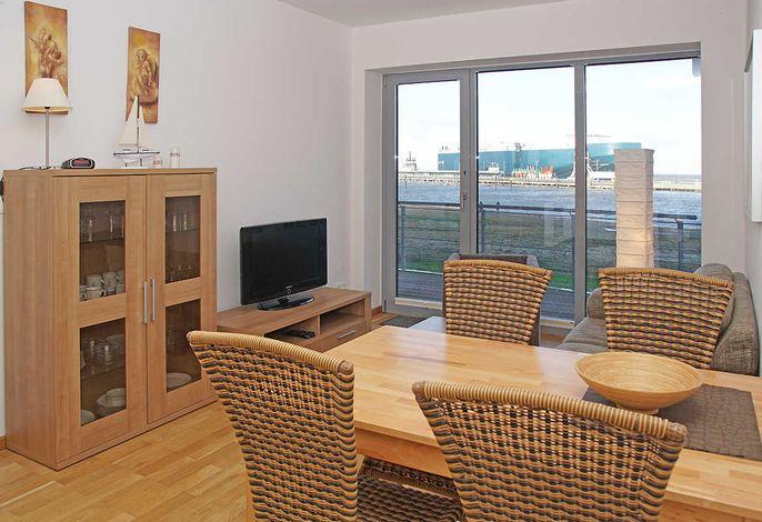 Wohnzimmer mit Essplatz und Seesicht
