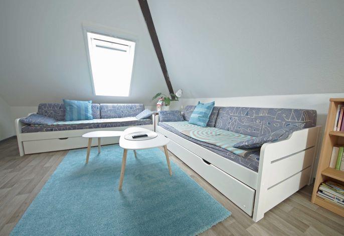 Wohnzimmer mit 2 Schlafsofas