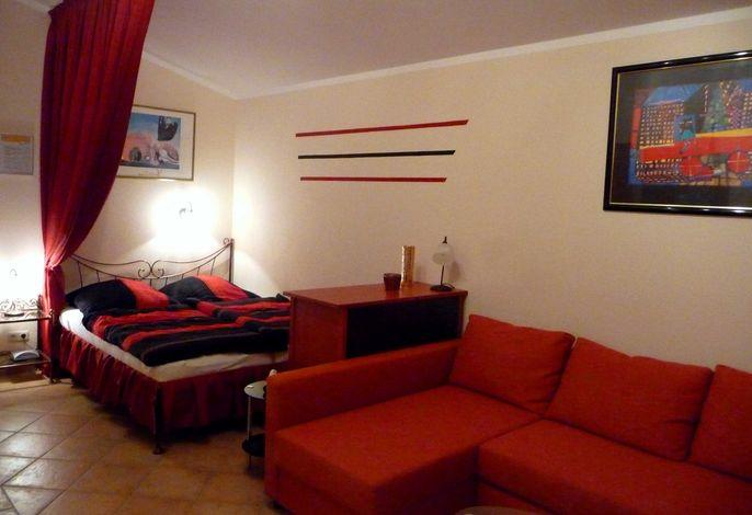 Appartement Leuchtturm - Doppelbett und Ecksofa mit 2 Aufbettungsmöglichkeiten
